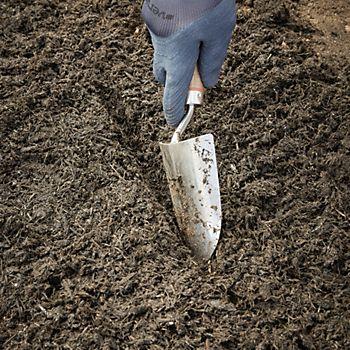trowel digging soil