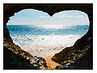 Heart shaped sea image Multicolour Canvas art (W)770mm (H)570mm