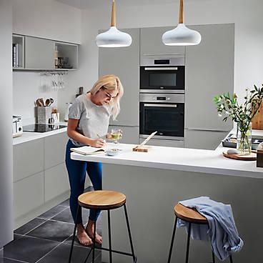 Woman in Balsamita Matt Grey Slab kitchen roomset
