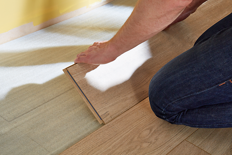Laminate and wood flooring fitting systems