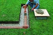How to repair & build a brick garden wall